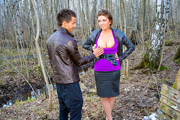 Busty girl gives public blowjob